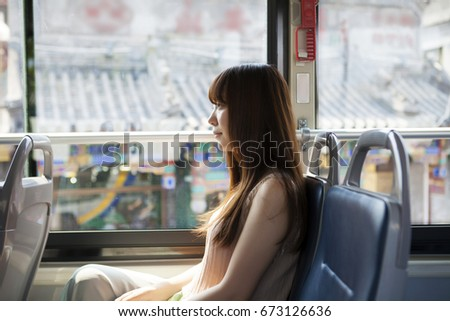 The girl sitting in the bus #673126636