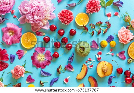 Beautiful summer arrangement with flowers and fruits #673137787
