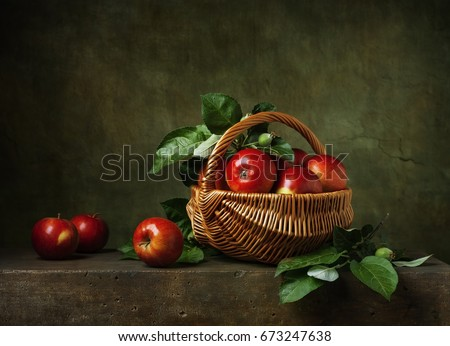 Still life with apples in a basket #673247638