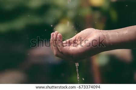Splashing Water on Hand #673374094