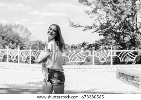 Young sweet blonde girl in casual style walk in park and feeling beautiful #673380565