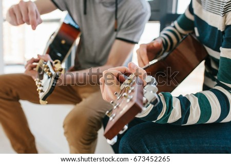 Learning to play the guitar. Music education and extracurricular lessons. #673452265
