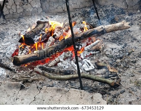 Burning wood prepared for cooking at the grill #673453129