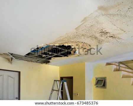 Water Leak. Water leaks down the rooftop floor.  Royalty-Free Stock Photo #673485376