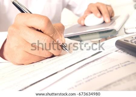 Man Working at Desk #673634980