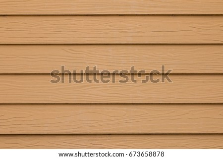 Wooden rake. Texture, background. Wooden plank on the wall of the house. #673658878