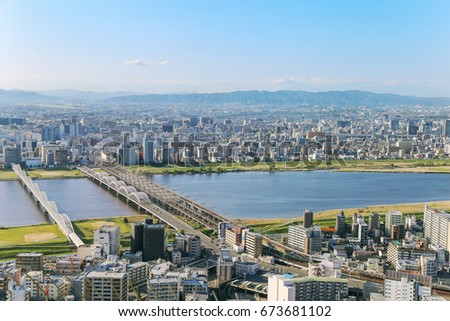 Osaka, Japan, shore of Yodo river. View from famous Umeda Sky Building. May 5,  2017 #673681102