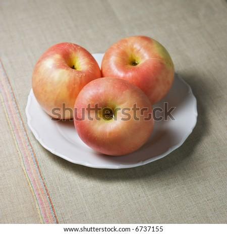 Closeup of three apples (fuji). Shallow focus depth on front apple #6737155