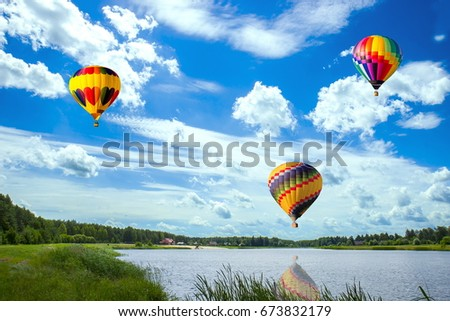 Balloons fly over the lake. #673832179