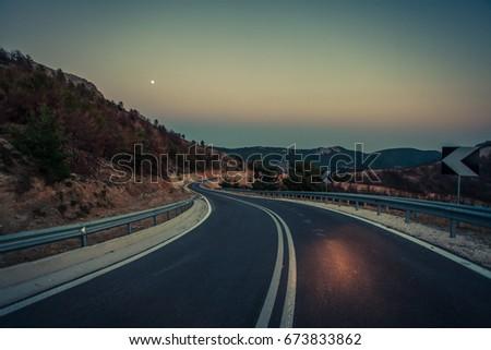 Serpentine road at night. #673833862