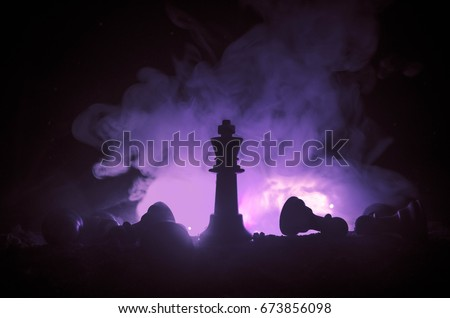 chess board game concept of business ideas and competition and strategy ideas concep. Chess figures on a dark background with smoke and fog. #673856098