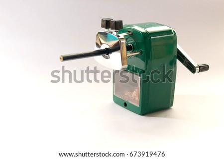 Green pencil sharpener machine on white background. #673919476