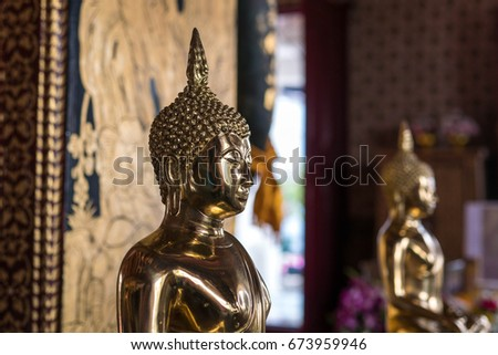 Bangkok,Thailand July 05,2017:The Buddha statue in Wat Pichaya Yatigaram(Pichaya Yatigaram Temple) #673959946