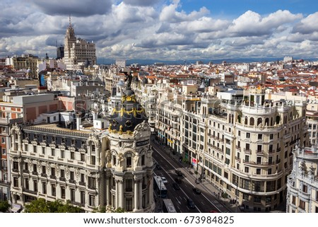 MADRID, SPAIN - OCT 10, 2014: Panoramic view on Gran Via, the main shopping street in Madrid, Spain. #673984825
