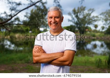 Handsome middle age man outdoor portrait. #674079556