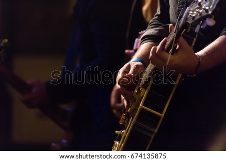 Artist guitarist playing electric guitar on concert stage #674135875