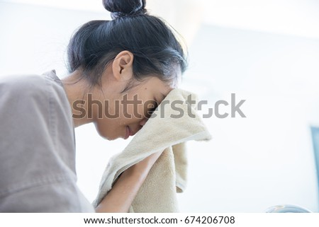 Asian women were wiped clean face after washing face She is in the bathroom #674206708