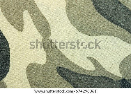 Military army camouflage fabric texture pattern background for design. Military army camouflage background. Military army camouflage pattern cloth. Military army camouflage texture. #674298061