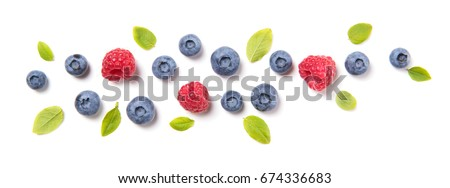 Fresh blueberries with leaves and raspberries, berry ornament isolated on white background, top view Royalty-Free Stock Photo #674336683