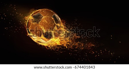 Sport. Soccer ball in flame closeup image. Soccer ball isolated on black background. Football energy. Royalty-Free Stock Photo #674401843