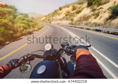 The Road view over the handlebars of motorcycle #674402218