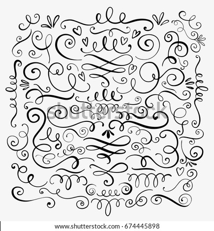 Hand drawn decorative curls and swirls. A collection of vintage vector design elements. Ink illustration. Royalty-Free Stock Photo #674445898