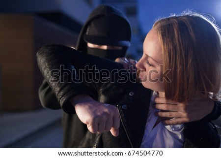 self-defense of woman against criminal with violence at robbery or kidnapping Royalty-Free Stock Photo #674504770
