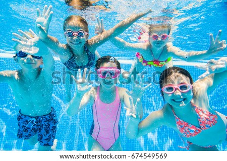 little kids swimming  in pool  underwater. Royalty-Free Stock Photo #674549569