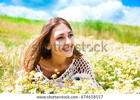 Fashion beautiful girl in the field with bouquet of wildflowers #674618557