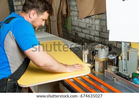 Man works for Edge Banding Machine #674635027