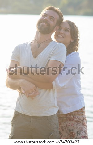 Happy couple have fun outdoor in the park / Happy couple have fun outdoor on the lake #674703427
