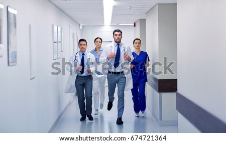 clinic, people, health care and medicine concept - group of medics runing along hospital #674721364