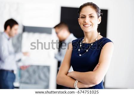 Attractive office worker standing #674751025