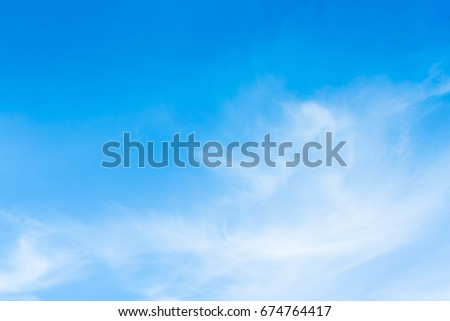 The blue sky with the backdrop of contrasting clouds is an inviting image. #674764417