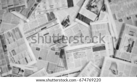 Lots of old newspapers on horizontal surface. Background texture, top view, blurred Royalty-Free Stock Photo #674769220