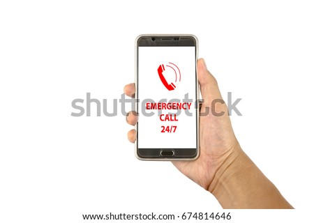 Hand holding a smartphone with text emergency call 24/7 on white background. The emergency telephone number is a special case in the country's telephone number plan. #674814646
