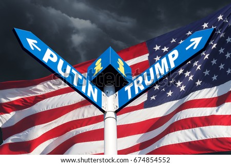 Confrontation between Russia and America. The names of Presidents Putin and Trump on the roadside sign on the background of the American flag and a stormy sky #674854552