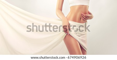 Perfect slim toned young body of the girl . An example of sports , fitness or plastic surgery and aesthetic cosmetology. Healthy Breast . #674906926