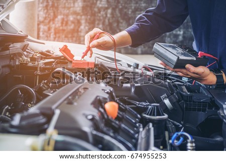 Hands of car mechanic  working in auto repair service. Royalty-Free Stock Photo #674955253