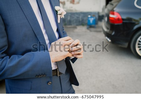 Groom hands #675047995
