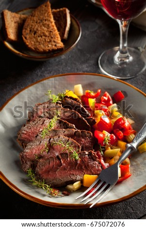 Preserved grilled meat and marinated vegetables: tomatoes, pepper, onion, celery.   #675072076