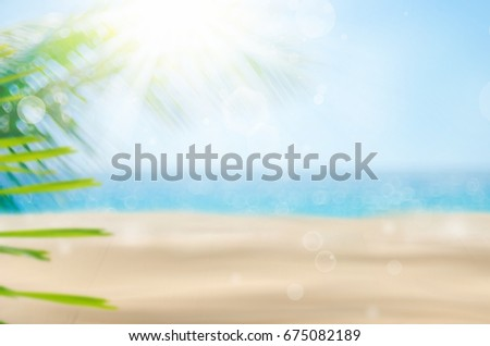 Blur beautiful nature green palm leaf on tropical beach with bokeh sun light wave abstract background. Copy space of summer vacation and business travel concept. Vintage tone filter effect color style #675082189