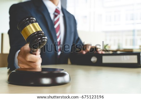 Justice and Law concept. lawyer working at courtroom, selective focus Royalty-Free Stock Photo #675123196