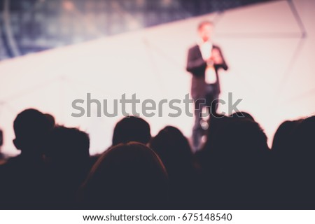 Disfocus of The Speaker Talking About Business Conference. Audience at the conference hall. Business and Entrepreneurship event. Royalty-Free Stock Photo #675148540