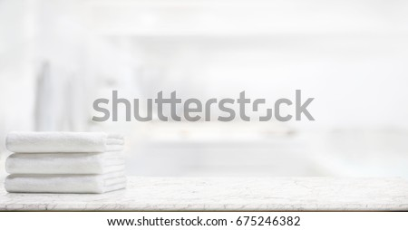 panorama shot : Towels on marble top table with copy space on blurred bathroom background. For product display montage. Royalty-Free Stock Photo #675246382