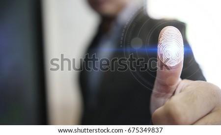 Businessman login with fingerprint scanning technology. fingerprint to identify personal, security system concept                                        #675349837