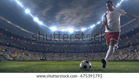 Soccer player kicks the ball with his feet during a soccer game on a professional outdoor soccer stadium. He wears unbranded soccer uniform. Stadium and crowd are made in 3D. #675391792