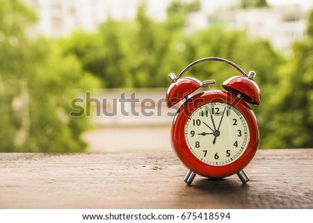 red Retro 9 o'clock and Morning sun with Bright and Flare Day Light Blur Green Garden Background with space for text. time management background. time is money idea, sign, concept #675418594