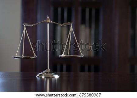 Symbol of Law on Lawyer's desk #675580987