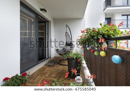 Home terrace with wooden floor and chair Royalty-Free Stock Photo #675585040